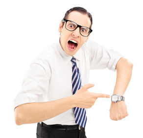 Angry man shouting and pointing on a wrist watch isolated against white background